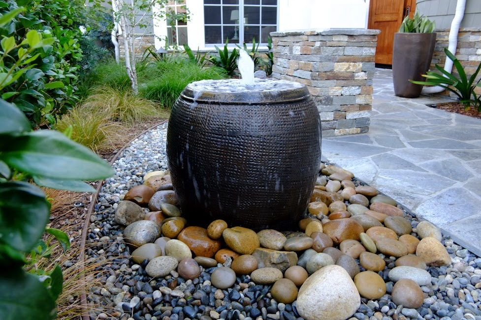 How to make a garden fountain out of well anything you for Garden waterfall
